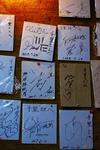 キングタコスパーラー千里 壁に貼られたサイン.jpg